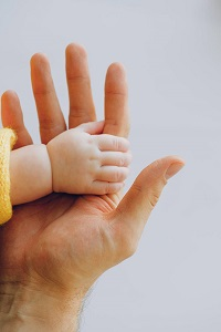 baby hand smaller